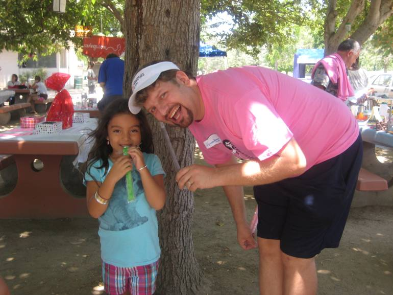 Bargain Hubby and a young festival goer enjoy free Otter Pops