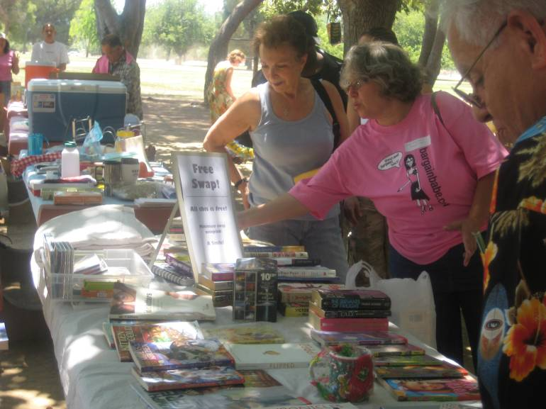 Volunteer Bobbi running a free swap - one of the most popular events at Frugal Fe$t!